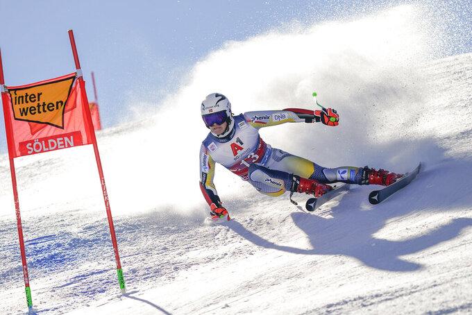 Norway's Lucas Braathen speeds down the course on his way to win an alpine ski, men's World Cup giant slalom in Soelden, Austria, Sunday, Oct. 18, 2020. (AP Photo/Giovanni Auletta)
