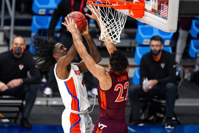 Virginia Tech Hokies guard Nahiem Alleyne (4) shoots over Virginia Tech Hokies forward Keve Aluma (22) in the first half of a first round game in the NCAA men's college basketball tournament at Hinkle Fieldhouse in Indianapolis, Friday, March 19, 2021. (AP Photo/Michael Conroy)