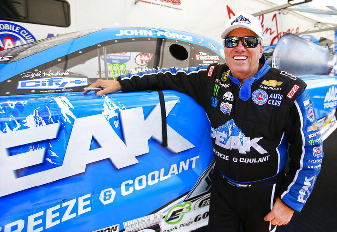 FILE - In this Saturday May 21, 2016 file photo, Funny Car driver John Force looks to get back on track for the last day of qualifying at the NHRA Kansas Nationals at Heartland Park. NHRA legend John Force is back with the drag racing series after a yearlong hiatus prompted by the coronavirus pandemic. The 16-time champion will make his much-anticipated return in the season-opening Gatornationals that begin Friday, March 12, 2021.  (Chris Neal/The Topeka Capital-Journal via AP, File)