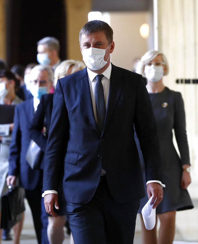 In this picture taken on Wednesday, May 27, 2020, Czech Republic's Foreign Minister Tomas Petricek walks to meet with Poland's Foreign Minister Jacek Czaputowicz as they meet in Prague, Czech Republic. Petricek was fired on Monday April. 12, 2021, in a government re-shuffle less than half a year before the parliamentary election. The move came after Foreign Minister Tomas Petricek failed to beat Interior Minister Jan Hamacek in a vote to become the new leader of the Social Democrats at their party congress last week.(AP Photo/Petr David Josek)