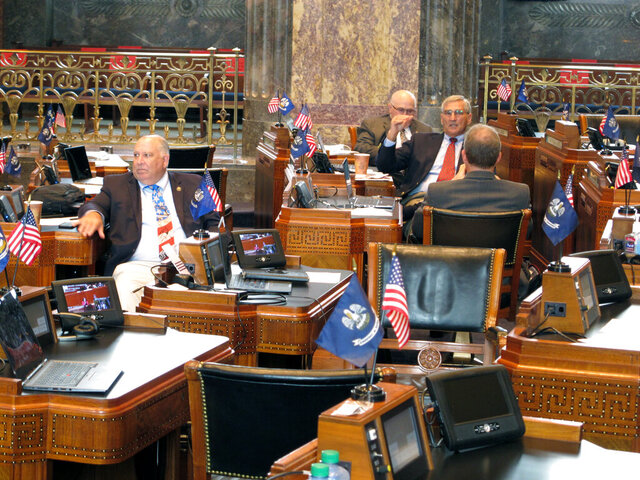 Senators talk as they await final bill debates on the Senate floor on the final day of the special session on Friday, Oct. 23, 2020, in Baton Rouge, La. (AP Photo/Melinda Deslatte)
