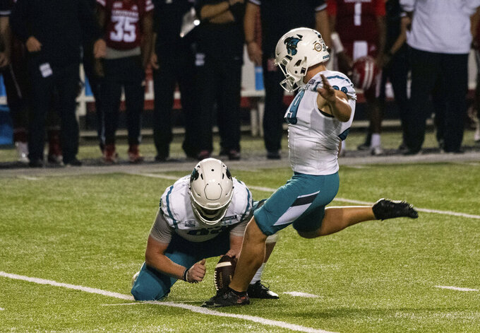 Coastal Carolina place kicker Massimo Biscardi (29) kicks the eventual game-winning field goal during the second half of an NCAA college football game against Louisiana-Lafayette in Lafayette, La., Wednesday, Oct. 14, 2020. (AP Photo/Paul Kieu)