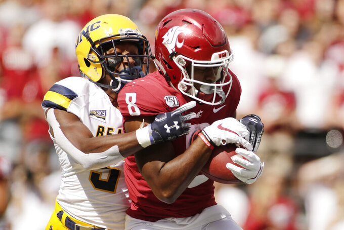 Washington State wide receiver Easop Winston Jr., right, catches a pass while defended by Northern Colorado cornerback Michael Walker during the first half of an NCAA college football game in Pullman, Wash., Saturday, Sept. 7, 2019. (AP Photo/Young Kwak)