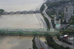 A part of a main road near the Han River is flooded due to heavy rain in Seoul, South Korea, Thursday, Aug. 6, 2020. Torrential rains continuously pounded South Korea on Thursday, prompting authorities to close parts of highways and issue a rare flood alert near a key river bridge in Seoul. (AP Photo/Lee Jin-man)