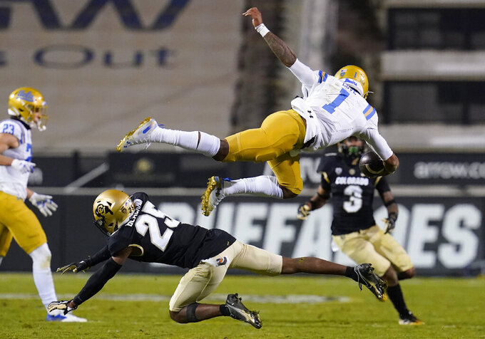Colorado cornerback Mekhi Blackmon, bottom, upends UCLA quarterback Dorian Thompson-Robinson as he runs for a short gain in the second half of an NCAA college football game Saturday, Nov. 7, 2020, in Boulder, Colo. (AP Photo/David Zalubowski)