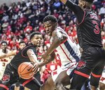 Arkansas State's Christian Willis, left, knocks the ball away from Mississippi's Sammy Hunter (23) as Arkansas State's Malik Brevard (3) defends during the first half of an NCAA college basketball game, Friday, Nov. 8, 2019 in Oxford, Miss. (Bruce Newman/The Oxford Eagle via AP)