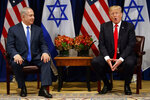 FILE - In this Sept. 18, 2017, file photo, President Donald Trump speaks during a meeting with Israeli Prime Minister Benjamin Netanyahu at the Palace Hotel during the United Nations General Assembly. Netanyahu's recent troubles have some parallels to those of his good friend Trump. Both face an array of corruption allegations, both have lashed out at the media and investigators, and both suffered major setbacks this week at the hands of career government officials. (AP Photo/Evan Vucci, File)