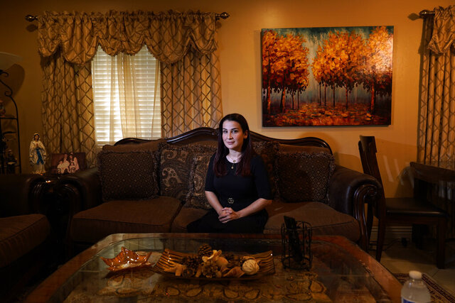 Iraqi immigrant Ethar Kakoz, a contact tracer for the COVID-19 virus, sits for a portrait Thursday, Oct. 22, 2020, in El Cajon, Calif. Kakoz is among a growing legion of ethnically and racially diverse contact tracers hired by local health departments to bridge the cultural divide in the United States and rebuild public confidence in America's public health system. (AP Photo/Gregory Bull)