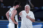 San Antonio Spurs head coach Gregg Popovich, right, speaks with Drew Eubanks during the first half of an NBA basketball game against the Memphis Grizzlies, Sunday, Aug. 2, 2020, in Lake Buena Vista, Fla. (AP Photo/Ashley Landis, Pool)