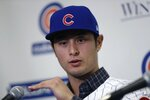 Chicago Cubs starting pitcher Yu Darvish responds during a media availability at the team's spring training baseball facility Tuesday, Feb. 13, 2018, in Mesa, Ariz. Darvish signed a $126 million, six-year contract over the weekend. (AP Photo/Carlos Osorio)