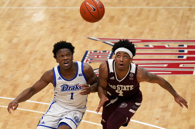 Drake's Joseph Yesufu (1) and Missouri State's Ja'Monta Black (4) chase a loose ball during the second half of an NCAA college basketball game in the semifinal round of the Missouri Valley Conference men's tournament Saturday, March 6, 2021, in St. Louis. (AP Photo/Jeff Roberson)