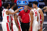 Houston head coach Kelvin Sampson talks to his team in the first half of a Sweet 16 game against Syracuse in the NCAA men's college basketball tournament at Hinkle Fieldhouse in Indianapolis, Saturday, March 27, 2021. (AP Photo/AJ Mast)