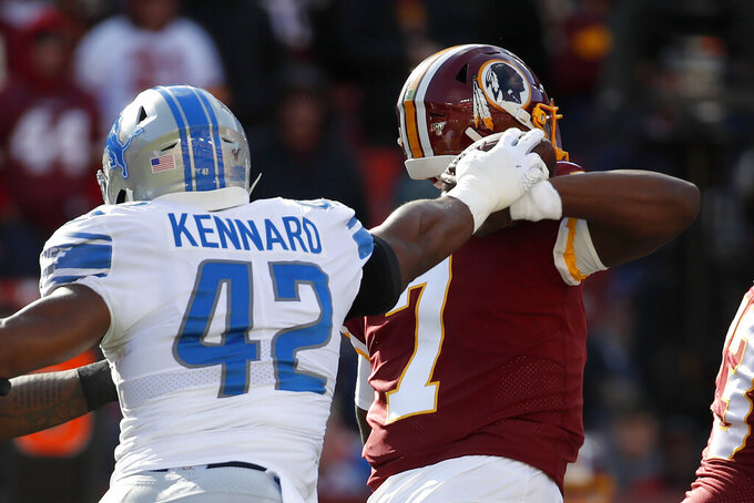 Detroit Lions outside linebacker Devon Kennard strips the ball off Washington Redskins quarterback Dwayne Haskins's hand forcing a fumble during the first half of an NFL football game, Sunday, Nov. 24, 2019, in Landover, Md. The ball was recovered by the Lions. (AP Photo/Alex Brandon)