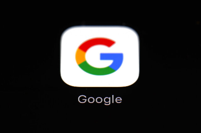 FILE - This March 19, 2018, file photo shows a Google app in Baltimore. Google will try to make a bigger splash in the smartphone market with a cheaper high-end model while it also aims to expand its presence on bigger screens with a new TV service. The products unveiled Wednesday, Sept. 30, 2020, focus on two areas where Google has struggled to make significant inroads. (AP Photo/Patrick Semansky, File)