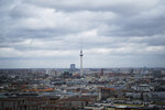 FILE - In this Friday, March 13, 2020 file photo, the television tower stands under clouds in the German capital Berlin, Germany. Voters in Berlin backed a non-binding, controversial proposal for the Berlin regional government to take over about 240,000 apartments worth billions from corporate owners to curb sharply rising rents in the German capital. (AP Photo/Markus Schreiber, File)
