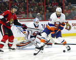 New York Islanders defenseman Johnny Boychuk (55) defends against Ottawa Senators left wing Brady Tkachuk (7) as Islanders goaltender Thomas Greiss (1) looks on during first-period NHL hockey game action in Ottawa, Ontario, Friday, Oct. 25, 2019. (Fred Chartrand/The Canadian Press via AP)