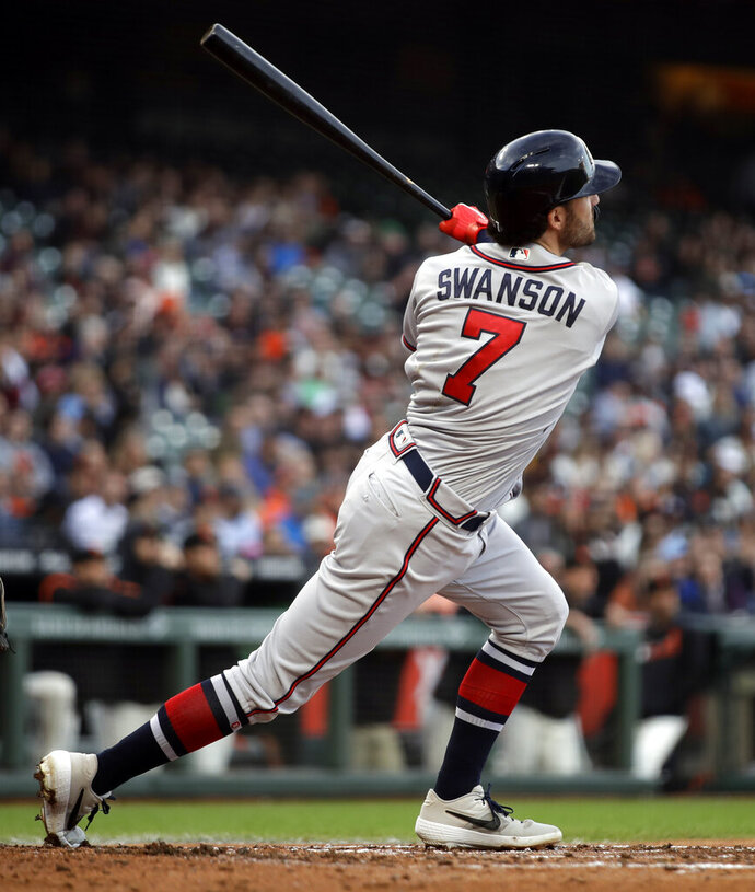 Atlanta Braves' Dansby Swanson watches his three-run home run off San Francisco Giants' Jeff Samardzija during the second inning of a baseball game Wednesday, May 22, 2019, in San Francisco. (AP Photo/Ben Margot)
