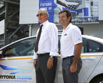 FILE - In this July 1, 2015, filer photo, then-NASCAR executive vice president Jim France, left, and then-Daytona International Speedway president Joie Chitwood III pose during the announcement that Chevrolet will become a partner in the Daytona Uprising expansion project, in Daytona Beach, Fla. Jim France is running NASCAR the same way he lives his day-to-day life _ quietly, in the background, away from the spotlight he never craved. (Joe Burbank/Orlando Sentinel via AP, File)
