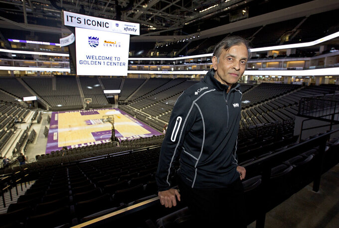 "FILE - In this Sept. 27, 2016, file photo, Vivek Ranadive, the majority owner of the Sacramento Kings, poses in the new Golden 1 Center in Sacramento, Calif. Golden 1 Center will be among the places Californians in the area can vote from Saturday until the polls close on the evening of Nov. 3. ""There's no better way to make the world a better place than by making it easy for people to vote,"" Ranadive said in a telephone interview with The Associated Press. (AP Photo/Rich Pedroncelli, File)"