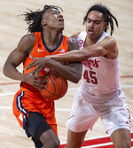 Illinois' Ayo Dosunmu (11) is fouled by Nebraska guard Dalano Banton (45) during the first half of an NCAA college basketball game on Friday, Feb. 12, 2021, in Lincoln, Neb. (Francis Gardler/Lincoln Journal Star via AP)