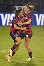United States' Tobin Heath, left, celebrates her goal with Lindsey Horan during the second half of an international friendly soccer match against Mexico, Thursday, July 1, 2021, in East Hartford, Conn. (AP Photo/Jessica Hill)