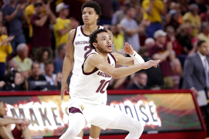 Arizona State guard Jaelen House (10) reacts to a teammate making a three pointer during the first half of an NCAA college basketball game against Washington State Saturday, March 7, 2020, in Tempe, Ariz. (AP Photo/Matt York)