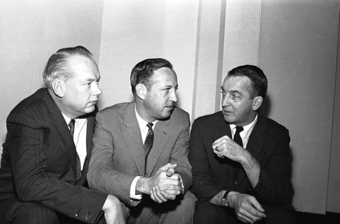 FILE - In this February 1966 file photo, NFL commissioner Pete Rozelle, center, discusses a new television contract for championship games with Bill MacPhail, left, vice president of CBS-TV, and John Reynolds, president of CBS-TV network, in Palm Beach, Fla. Pete Rozelle would not be surprised to see the NFL's impact of television as it celebrates its 100th season this year. It was Rozelle, the commissioner from 1960 to 1989, who was able to convince owners that it was in their best interest to sign a leaguewide rights deal instead of teams negotiating on their own.  (AP Photo/File)