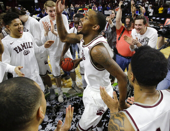 Montana's Sayeed Pridgett and his teammates celebrate their 68-62 win over Eastern Washington after an NCAA college basketball game in the championship of the Big Sky Tournament in Boise, Idaho, Saturday, March 16, 2019. (AP Photo/Otto Kitsinger)