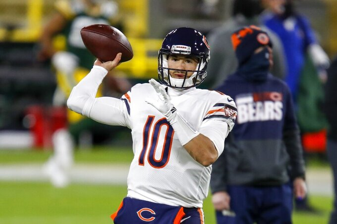 Chicago Bears' Mitchell Trubisky warms up before an NFL football game against the Green Bay Packers Sunday, Nov. 29, 2020, in Green Bay, Wis. (AP Photo/Matt Ludtke)