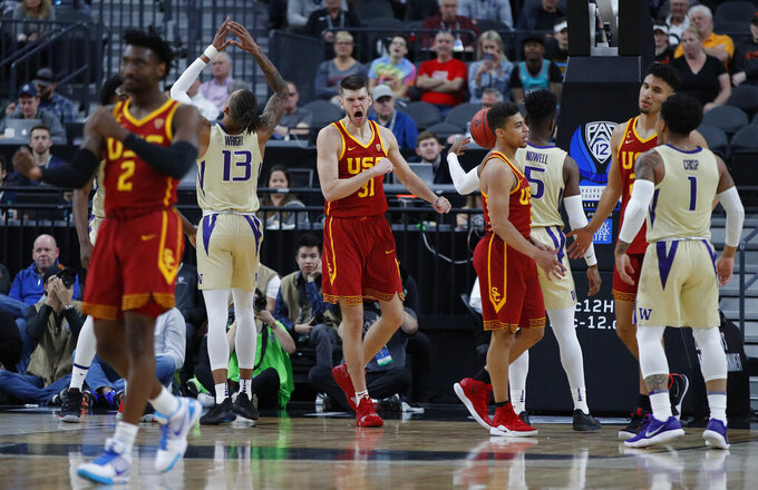 Southern California's Nick Rakocevic, center, reacts after a play against Washington during the first half of an NCAA college basketball game in the quarterfinal round of the Pac-12 men's tournament Thursday, March 14, 2019, in Las Vegas. (AP Photo/John Locher)