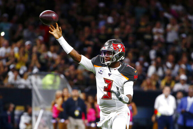 Tampa Bay Buccaneers quarterback Jameis Winston (3) shows a touchdown pass in the first half of an NFL football game against the New Orleans Saints in New Orleans, Sunday, Oct. 6, 2019. (AP Photo/Butch Dill)