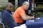 Houston Astros owner Jim Crane, right, and manager Dusty Baker listen to a question during a news conference before the start of the first official spring training baseball practice for the team Thursday, Feb. 13, 2020, in West Palm Beach, Fla. (AP Photo/Jeff Roberson)