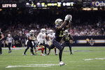 New Orleans Saints wide receiver Michael Thomas (13) pulls in a touchdown reception in the second half an NFL football game against the San Francisco 49ers in New Orleans, Sunday, Dec. 8, 2019. (AP Photo/Brett Duke)