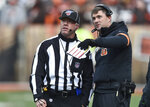 Cincinnati Bengals head coach Zac Taylor, right, talks with an official during the first half of an NFL football game against the Cleveland Browns, Sunday, Dec. 8, 2019, in Cleveland. (AP Photo/David Richard)