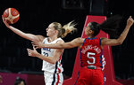 France's Marine Johannes (23), left, drives to the basket past United States' Skylar Diggins (5) during women's basketball preliminary round game at the 2020 Summer Olympics, Monday, Aug. 2, 2021, in Saitama, Japan. (AP Photo/Charlie Neibergall)
