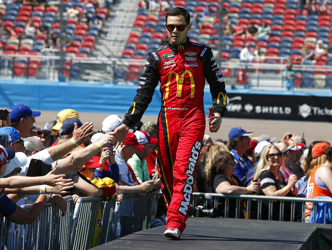 Kyle Larson is greeted by fans during driver introductions prior to the start of the NASCAR Cup Series auto race at ISM Raceway, Sunday, March 10, 2019, in Avondale, Ariz. (AP Photo/Ralph Freso)