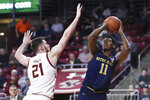 Notre Dame forward Juwan Durham (11) shoots over Boston College forward Nik Popovic (21) during the first half of an NCAA men's college basketball game in Boston, Wednesday, Feb. 26, 2020. (AP Photo/Charles Krupa)