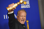 Stellan Skarsgard poses in the press room with the award for best performance by an actor in a supporting role in a series, limited series or motion picture made for television for