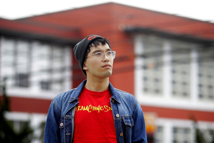 In this March 31, 2020, photo, Kyle Navarro poses in San Francisco. The school nurse was recently unlocking his bicycle when an older white man called him a racial slur and spat at him. Asian Americans are using social media to organize and fight back against racially motivated attacks during the coronavirus pandemic, which the FBI predicts will increase as infections grow. (AP Photo/Jeff Chiu)