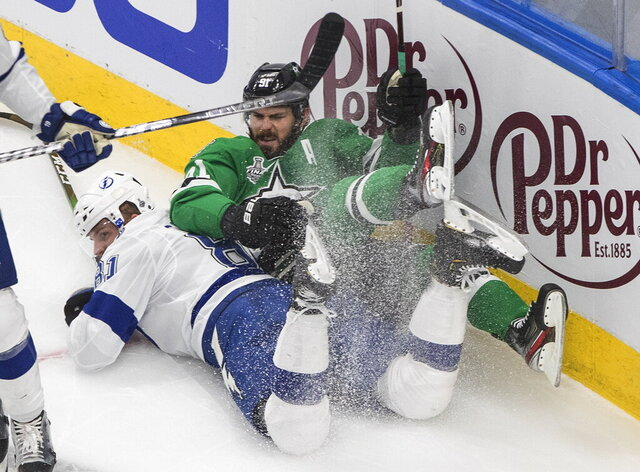 Tampa Bay Lightning's Erik Cernak (81) checks Dallas Stars' Tyler Seguin (91) during first-period NHL Stanley Cup finals hockey game action in Edmonton, Alberta, Monday, Sept. 28, 2020. (Jason Franson/The Canadian Press via AP)