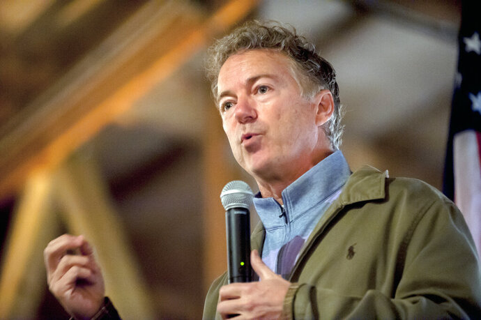 FILE - In this Nov. 5, 2018 file photo, U.S. Sen. Rand Paul, R-Ky., speaks at a Republican Party rally at Highland Stables in Bowling Green, Ky.  Paul's attorneys say the Republican lawmaker's political views should be off-limits at his upcoming civil trial against his neighbor. The attorneys say his political beliefs could