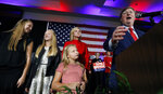Republican Gov.-elect Tate Reeves addresses his supporters at a state GOP election night event, as wife, Elee Reeves, rear, and daughters Sarah, left, Elizabeth, second from left, and Madeline, foreground, listen, Tuesday, Nov. 5, 2019, in Jackson, Miss. Reeves defeated Democratic Attorney General Jim Hood. (AP Photo/Rogelio V. Solis)
