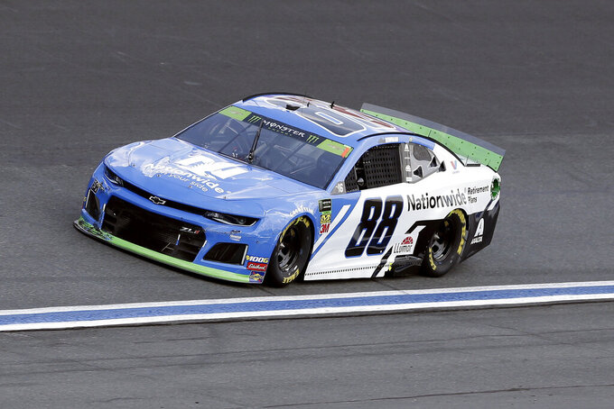 Alex Bowman drives through Turn 4 during the NASCAR Cup Series auto race at Charlotte Motor Speedway in Concord, N.C., Sunday, Sept. 29, 2019. (AP Photo/Gerry Broome)