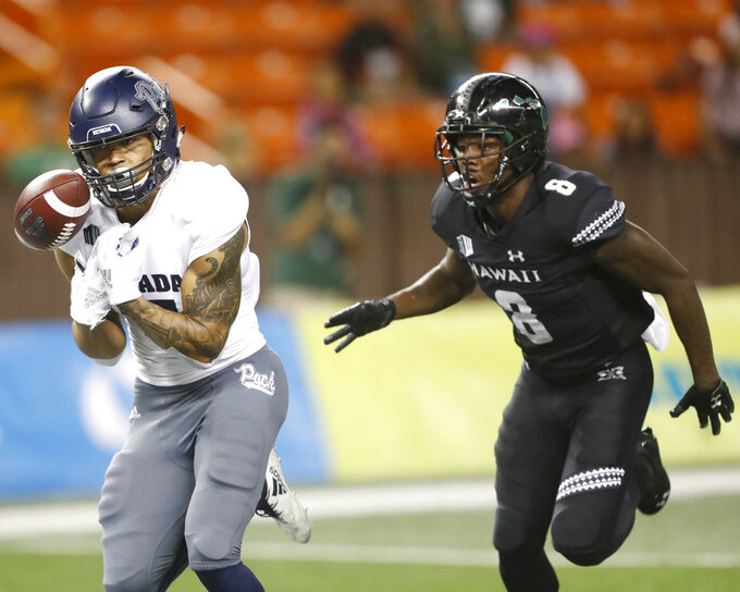 While being guarded by Hawaii defensive back Eugene Ford (8), Nevada wide receiver Brendan O'Leary-Orange (17) can't hold on to a pass during the third quarter of an NCAA college football game Saturday, Oct. 20, 2018, in Honolulu. (AP Photo/Marco Garcia)