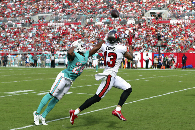 Tampa Bay Buccaneers wide receiver Mike Evans (13) beats Miami Dolphins cornerback Byron Jones (24) on a 34-yard touchdown pass from quarterback Tom Brady during the second half of an NFL football game Sunday, Oct. 10, 2021, in Tampa, Fla. (AP Photo/Mark LoMoglio)