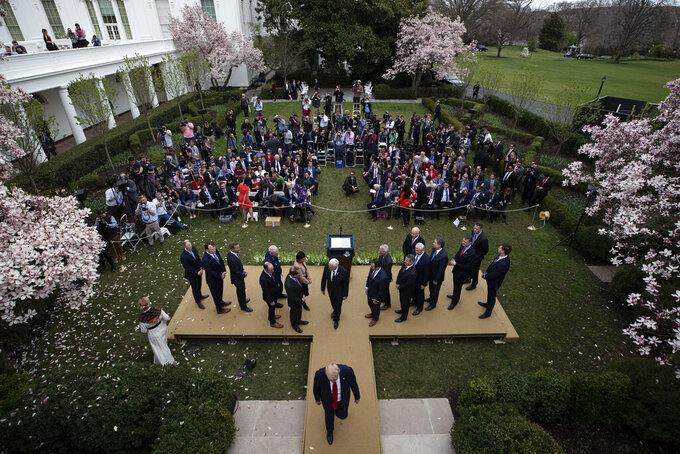 FILE - In this March 13, 2020 file photo, President Donald Trump departs after speaking during a news conference about the coronavirus in the Rose Garden at the White House in Washington. Melania Trump has announced plans to renovate the White House Rose Garden. It's the outdoor space steps away from the Oval Office. (AP Photo/Alex Brandon)