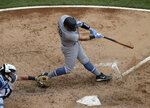 New York Yankees' Austin Romine hits a two-run single against the Chicago White Sox during the third inning of a baseball game in Chicago, Sunday, June 16, 2019. (AP Photo/Nam Y. Huh)