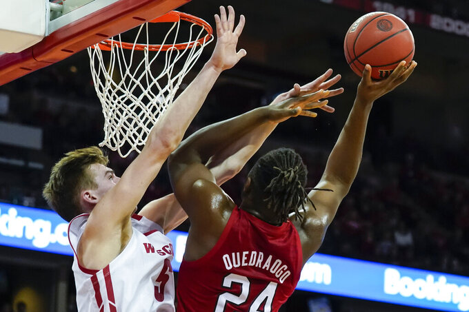 Wisconsin's Tyler Wahl (5) blocks out Nebraska's Yvan Ouedraogo (24) during the first half of an NCAA college basketball game Tuesday, Jan. 21, 2020, in Madison, Wis. (AP Photo/Andy Manis)