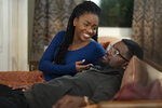 This image released by Universal Pictures shows Teyonah Parris and Lil Rel Howery in a scene from