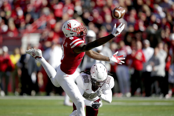 Nebraska wide receiver Stanley Morgan Jr. (8) can't reach the ball against Bethune-Cookman cornerback Trevor Merritt (20) during the first half of an NCAA college football game in Lincoln, Neb., Saturday, Oct. 27, 2018. (AP Photo/Nati Harnik)